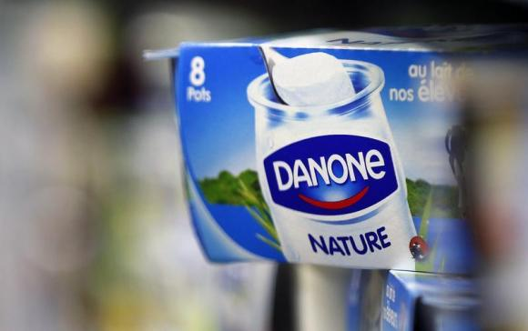 Yoghurt produced by French Dairy Group Danone are displayed on a shelf in an supermarket in Lanton  Danone raises its stake in China's leading dairy company Mengniu download 1
